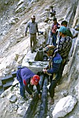 Engineers fitting a Pump after a land slide wiped out an irrigation canal, Gulmi District, Western Nepal