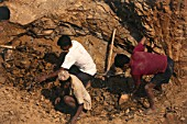 Workers Digging Hole in Ground in preparation to build a new road, Gulmi Village, Western Nepal, Himalaya.