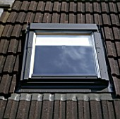 Loft conversion. Velux window installed in the attic.