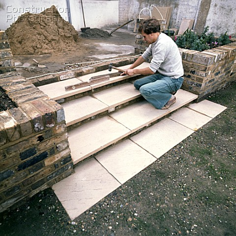 Laying slabs on a patio