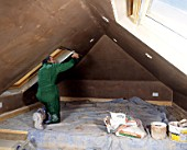Attic conversion. Plaster being applied to the walls.