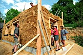 Volunteers and Expert Barbara Jones of Amazon Nails Erecting a Strawbale Building, Centre for Alternative Technology, Machynlleth, Mid Wales