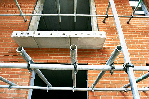 Scaffolding on brickwall