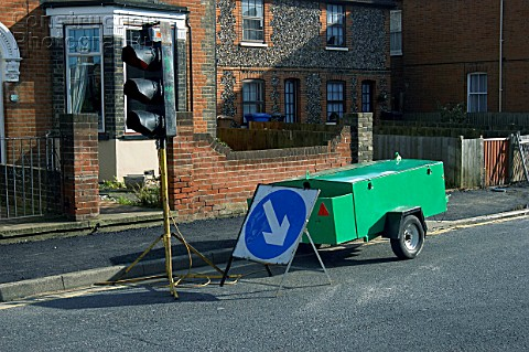 Generator and mobile traffic light at roadwork England UK
