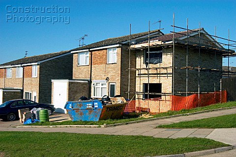 Extension being built on the side of a council house England UK