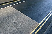 Coloured asphalt and yellow lines.