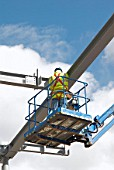 Construction worker inspecting steel beams on a platform