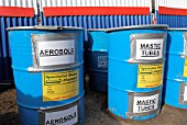 waste segregation of mastic tubes and aerosols on a building site.