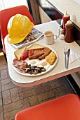 Builders cafe with full breakfast on table.