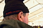 Man wearing woolly hat at plant auction
