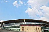 The Emirates Stadium in Ashburton Grove, north London, is the home of Arsenal Football Club. The stadium opened in July 2006, and has an all-seated capacity of 60,432, making it the second largest stadium in the Premiership after Manchester Uniteds Old Trafford, and the fourth largest sports stadium of any kind in England after Wembley Stadium and Twickenham. A naming rights deal with the airline Emirates was announced in 2004. The stadium project cost £390 million. The stadium is a four-tiered bowl with roofing over the stands. Constructed by Sir Robert McAlpine.