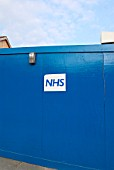 Hoarding on NHS building site.