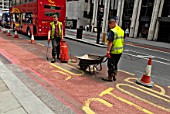 Construction road work at bus stop, City of London, England, UK