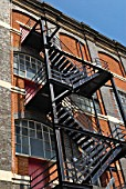 Fire escape staircase on a Victorian warehouse building, England, UK.