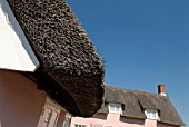 Thatched roof house, detail, Clare, Suffolk, UK.