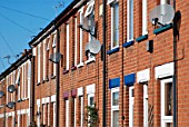 Terraced houses with satellite dishes, England, UK