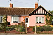 Mock tudor pink semi detached bungalow, Ipswich, Suffolk, UK