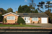 1970s bungalow with solar panel on roof, Ipswich, Suffolk, UK