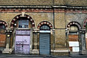 Dilapidated railway arch units, UK