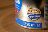 Tin of paint with sticker showing high percentage of VOC (Volatile Organic Compounds) contributing to atmospheric pollution