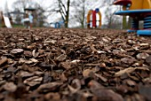 Playground surfacing with bark-based pine chipboards made of recycled material, Suffolk, England UK