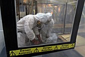 Asbestos Removal. Men in full protective clothing, United Kingdom