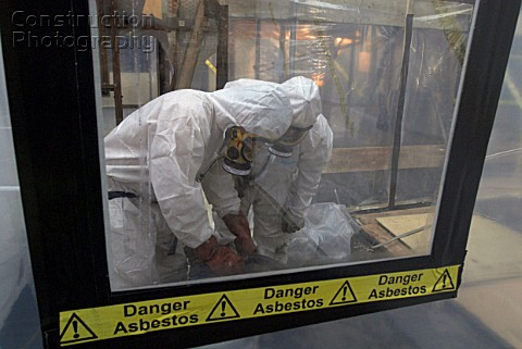 Asbestos Removal Men in full protective clothing United Kingdom