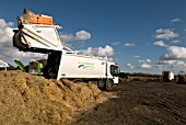 Truck unloading garden waste at site for recycling food and garden waste, Suffolk, UK