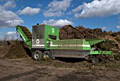 Composter producing compost at site for recycling food and garden waste, Suffolk, UK