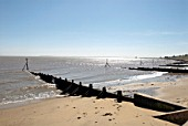 Groynes on sandy beach, Harwich, Essex, UK