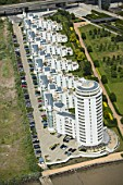 Aerial view of Barrier Park and Barrier Point, a landmark prestige housing development by Barratt, an 18-storey tower which has won 10 national awards. London Docklands, Thames Gateway, UK.