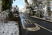 Speed limit sign on road in winter, UK