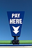 Pay here sign at car park