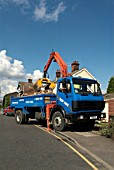 Lorry loading aggregate with a excavating arm, Ipswich, UK