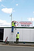 Construction site hoarding erected, UK
