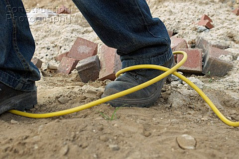 Site hazard tripping over an electric cable