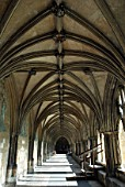 Arched passageway surrounding the Cloisters area of Norwich Cathedral, UK
