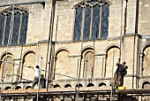 Erecting scaffolding around Norwich Cathedral, UK