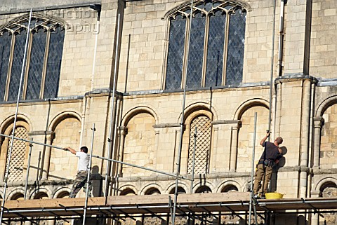 Erecting scaffolding around Norwich Cathedral UK