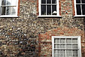 Exterior wall clearly displaying the insertion of a window in an old stone built cottage