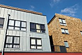 zinc sheet and cedar shingle cladding on a modern mixed-use development, London, UK