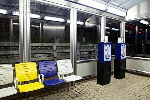 Ticket machines and waiting room at bus stop Kent UK night