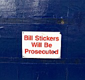 Bill stickers poster on a hoarding