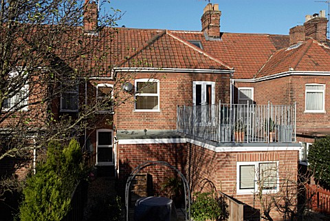 Extension with a roof terrace on the back of a terraced house Norwich Norfolk UK