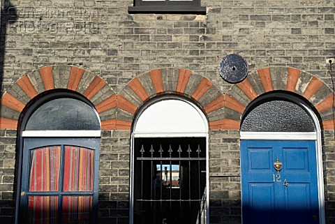 Decorative bricked arches above Victorian terraced housing front doors Norwich Norfolk UK