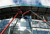 Mobile crane used to help lift the large glass windows into place during the construction of the 6000SQm office and showroom headquarters of Audi UK, West London, UK