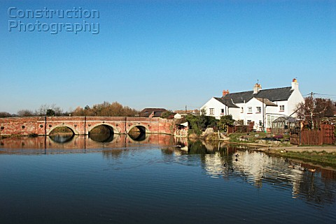 Village pond and bridge Cattawade Suffolk UK