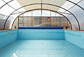 Empty swimming pool with polycarbonate roof