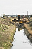 Construction work involving realigning a river at the South Lynn Millennium community development in Kings Lynn, one of seven UK sites set up in conjunction with English Partnerships and Local Government (CLG) which provide innovative homes in an environmentally friendly surrounding