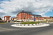 Roundabout junction built near a housing development, Colchester, Essex, UK